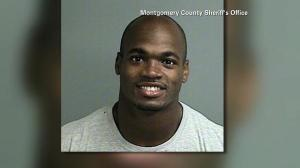 NFL player Adrian Peterson is seen in a booking photo after turning himself in on Friday, Sept. 12, 2014. (Credit: Montgomery County Sheriff's Office)