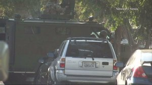 A SWAT team responded and a standoff ensued after a gunman shot at an ice cream truck in San Bernardino on Saturday, Sept. 14, 2014, authorities said. (Credit: Newspro News)