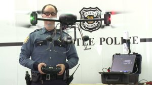 A still from a video showed Seattle police officers using a drone. The Seattle department gave its drones to LAPD in May 2014 amid controversy. (Credit: KCPQ)