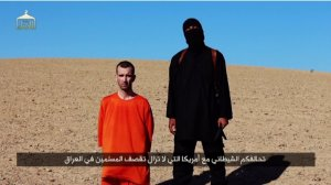 A video released on Saturday, Sept. 13, 2014, shows an ISIS militant executing British aid worker David Haines.