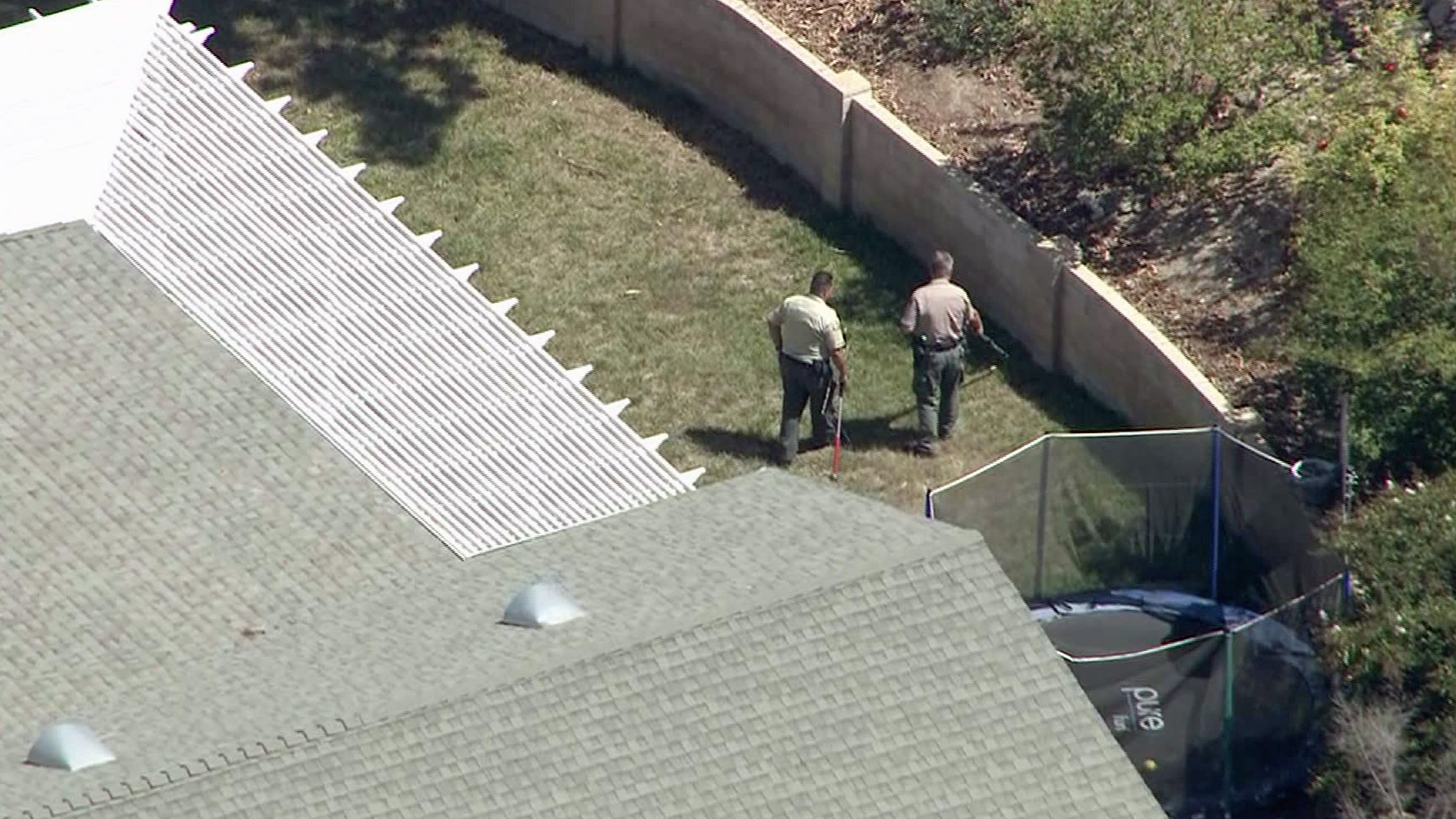 Officials search for a cobra in Thousand Oaks on Wednesday, Sept. 3, 2014.