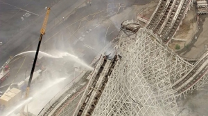 Flames charred a portion of the closed Colossus, collapsing the track, on Sept. 8, 2014. (Credit: KTLA)
