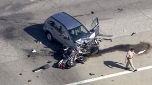 A motorist and police officer were hospitalized after a crash in Covina on Sept. 30, 2014. (CreditL KTLA)