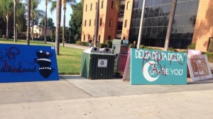 """RIP AV"" was spray painted on multiple sorority and fraternity signs at CSUN on Sept. 4, 2014, following the death of Armando Villa, a Pi Kappa Phi pledge. (Credit: KTLA)"