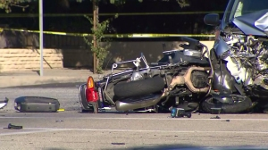 Officer Jordan Corder's motorcycle remained in the intersection after a collision that killed him in Covina on Sept. 30, 2014. (Credit: KTLA)