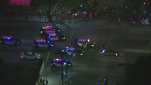 Crowds of people gathered to watch a man be detained following a slow-speed pursuit in El Monte on Sept. 8, 2014. (Credit: KTLA)