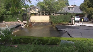 Pipe repairs were expected to take 12 hours after a water main break in Encino Monday, Sept. 8, 2014. (Credit: KTLA)