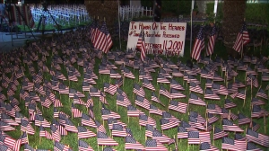 Orange County Firefighter Scott Townley has placed thousands of flags on his front lawn as part of a memorial dedicated to remembering those who lost their lives in the 9/11 attacks. (Credit: KTLA)