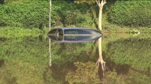 A car was mostly underwater after a flash flood hit parts of Riverside County on Sept. 7, 2014. (Credit: KTLA)