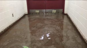 A hallway at Elsinore High School was flooded as a result of wild weather on Sept. 16, 2014. (Credit: KTLA)