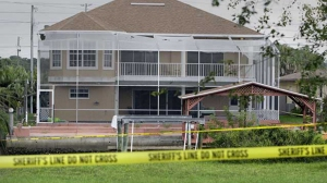 Four bodies were discovered near a Florida home during a welfare check on Sept. 4, 2014. (Credit: Tampa Bay Times)
