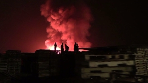 A fire at a pallet yard in Fontana on Sept. 14, 2014, caused $1 million worth of damage. (Credit:
