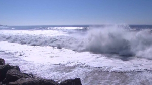High surf is seen buffeting the Southern California coast in a file photo. (Credit: KTLA)
