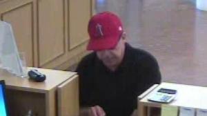 The Orange County Sheriff's Department released surveillance images capturing the Hills Bandit robbing a Laguna Niguel bank on Sept. 8, 2014.