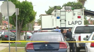 Investigators remained on the scene hours after a man involved in a domestic violence call was shot and killed by LAPD officers. (Credit: KTLA)