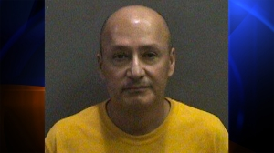Juan Martinez is seen in a booking photo provided by the Orange County Sheriff's Department.