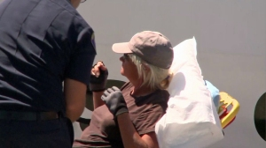 A boater is put on a stretcher in Newport Beach after being rescued several miles off shore. (Credit: KTLA)