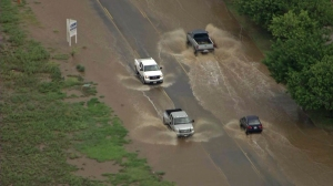 Streets were flooded in Lake Elsinore amid a thunderstorm on Sept. 16, 2014. (Credit: KTLA)