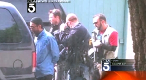 Exclusive photograph of an FBI raid in Chino that resulted in the arrests of three men accused on federal terrorism charges on Nov. 16, 2012. (Credit: KTLA)