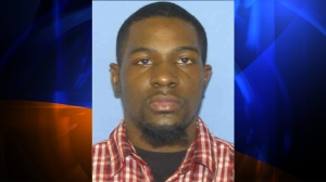 The suspect, Alton Nolen, is seen in a photo released by the Logan County Sheriff's Office.