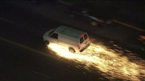 A van threw off sparks toward the end of a police pursuit in South Los Angeles on Sept. 17, 2014. (Credit: KTLA)