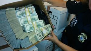 Authorities arrested nine people and seized tens of millions of dollars as part of and investigation into suspected money laundering related to drug trafficking. (Credit: Department of Justice)