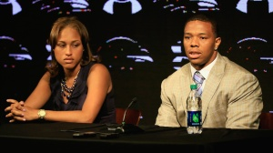 Running back Ray Rice of the Baltimore Ravens addresses a news conference with his wife Janay at the Ravens training center on May 23, 2014 in Owings Mills, Maryland. Rice spoke publicly for the first time since facing felony assault charges stemming from a February incident involving Janay at an Atlantic City casino. (Credit: Rob Carr/Getty Images)