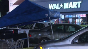 A body was discovered in the trunk of a vehicle outside a Walmart in Riverside on Saturday, Sept. 13, 2014, police said. (Credit: KTLA)