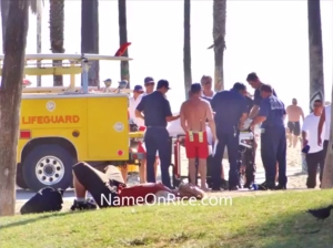 A photo taken at Venice Beach on Sept. 15, 2014, shows first responders treating a woman injured when she was run over by a lifeguard vehicle. (Credit: NameOnRice)