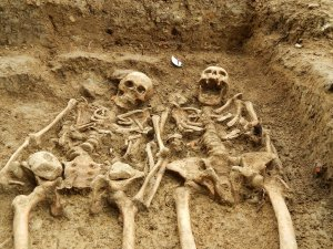 "A couple of skeletons which have been ""holding hands"" for 700 years have been uncovered at the lost chapel of St Morrell in Leicestershire, central England. (Credit: University of Leicester)"