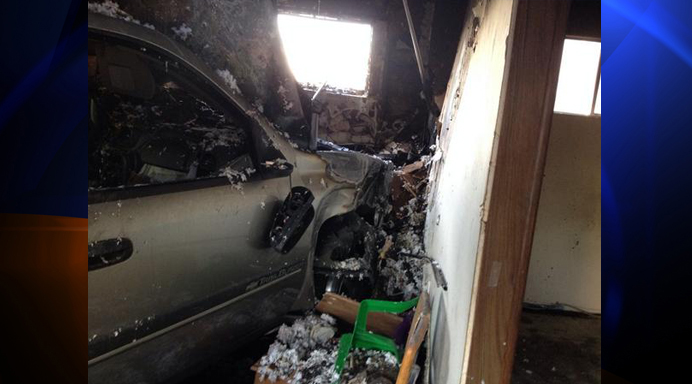 An SUV crashed into a bedroom of a Santa Ana home on Saturday, Sept. 13, 2014. (Credit: Orange County Fire Authority)