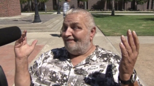 """""""I fell off, but it had nothing to do with her,"""" said the man in the video. He spoke outside his girlfriend's arraignment on Aug. 9, 2014. (Credit: KTLA)"""