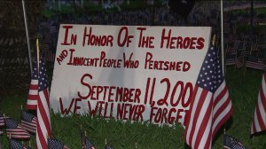 One of the signs placed on the front lawn of an Orange County firefighter's home as part of a memorial to victims of the 9/11 attacks. (Credit: KTLA)
