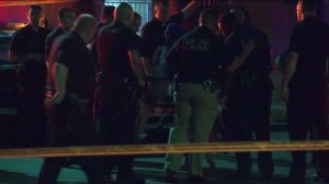 A husband was shot and killed by police after he allegedly opened fire on them on Sept. 8, 2014, authorities said. (Credit: KTLA)