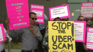 Around 200 Uber drivers protested Sept. 9, 2014, against recent pay cuts. (Credit: KTLA)