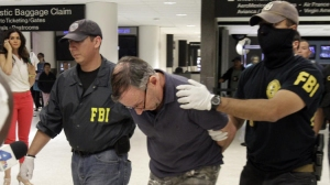 Walter Lee Williams was taken into custody in June 2013 by the FBI at Los Angeles International Airport. (Credit: Lawrence K. Ho / Los Angeles Times)