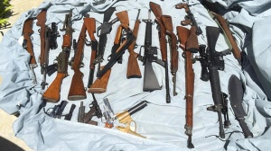 Weapons seized from a home in Laguna Niguel are seen in a photo provided by the Orange County Sheriff's Department on Tuesday, Sept. 2, 2014.