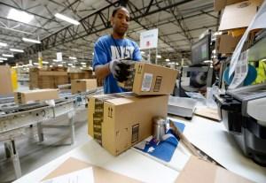 Employee Lamar Roby prepares shipping orders at Amazon's San Bernardino Fulfillment Center October 29, 2013. (Credit: Kevork Djansezian/Getty Images)
