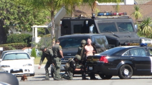 "A neighbor of Jason ""Mayhem"" Miller shared this photo of his arrest after a standoff that he live-tweeted on Oct. 9, 2014, in Mission Viejo."