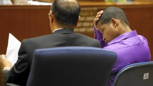 Javier Bolden, right, sits with his defense attorney, Andrew Goldman, during his trial in Los Angeles County Superior Court. (Credit: Michael Robinson Chavez / Los Angeles Times)