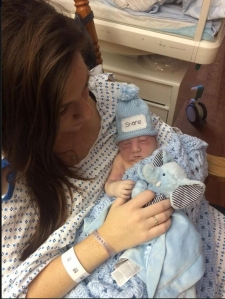 Jenna Shane is seen holding her new born son, Shane on the family's Facebook page.