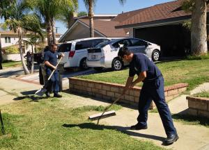 In a photo posted to the Corona Fire Department's Facebook page on Oct. 1, 2014, firefighters help a patient finish his yard work after he collapsed while mowing the lawn.