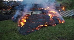 The June 27th lava flow burns vegetation as it approaches a property boundary above P hoa early on the morning of Tuesday, October 28, 2014. (Credit: USGS)