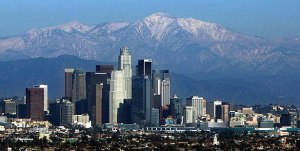 The snow-capped San Gabriel Mountains are a backdrop to the Los Angeles skyline as seen from Kenneth Hahn State Recreation Area in Baldwin Hills after a December 2009 storm. (Credit: Genaro Molina /Los Angeles Times)