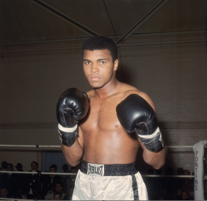 World heavyweight boxing champion Muhammad Ali in training at the Royal Artillery Gymnasium in London for his upcoming fight with British champion Henry Cooper, against whom he must defend his title. (Credit: Getty Images)