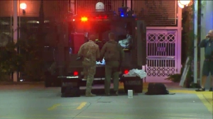 A Pomona police officer was taken to a hospital after being shot early Tuesday. (Credit: KTLA)