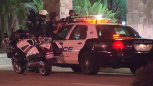 Police had guns drawn outside a Super 8 Motel in Torrance on Oct. 9, 2014. (Credit: KTLA)