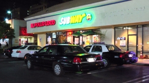 Police were investigating after three people used pepper-spray on employees during a robbery at a 24-hour Subway restaurant in North Hollywood. (Credit: Newsreel)