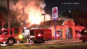 Flames erupted at a Taco Bell restaurant in San Bernardino on Oct. 28, 2014. (Credit: Loudlabs)