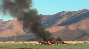 One person was killed Wednesday when a military aircraft crashed in a field near Point Mugu Naval Air Station. (Credit: Brian Rivera)